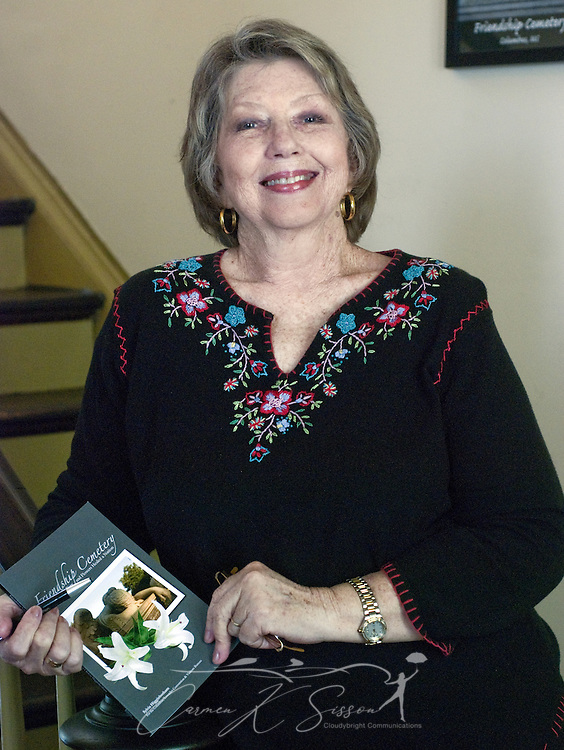 "Local author Sylvia Higginbotham holds her latest book, ""Friendship Cemetery: Where the Angel Wept...and Flowers Healed the Nation,"" during a book signing at the Tennessee Williams Welcome Center in Columbus, Miss. April 17, 2010. (Photo by Carmen K. Sisson/Cloudybright)"