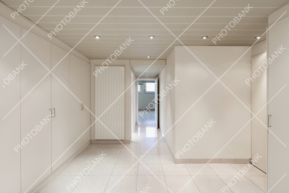 interior of an house, empty room with closets, tiled floor