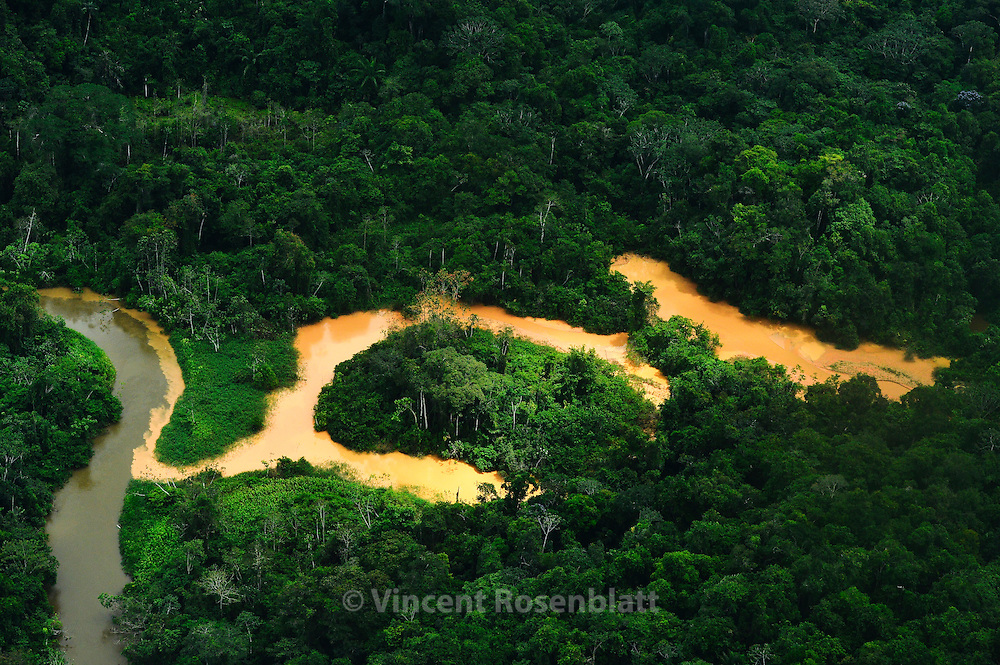 Gold Diggers action in the Yanomami Territory. The river is spoiled. Since this overflight, the Funai agency together with Yanomami did destroy this camp and remove the gold diggers. But they always come back.
