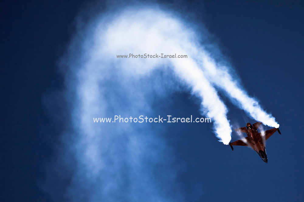 Israeli Air force F-15I Fighter jet in flight smoke is emitted from wing tips