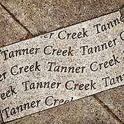 Inset paver detail marking the pre-development location of Tanner Creek, Flanders Street and NW 12th Avenue, Portland, Oregon.