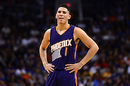 Feb 10, 2016; Phoenix, AZ, USA; Phoenix Suns guard Devin Booker (1) reacts on the court during the game against the Golden State Warriors at Talking Stick Resort Arena. The Golden State Warriors won 112-104. Mandatory Credit: Jennifer Stewart-USA TODAY Sports