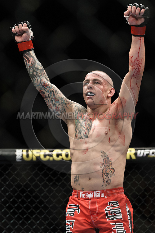 "MANCHESTER, ENGLAND, NOVEMBER 14, 2009: Ross Pearson celebrates his stopaage victory over Aaron Riley (not pictured) during ""UFC 105: Couture vs. Vera"" inside the MEN Arena in Manchester, United Kingdom."
