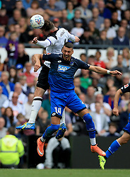 Derby County's Richard Keogh (Top) and TSG 1899 Hoffenheim's Sandro Wagner contest a header.