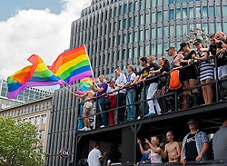 People on float waving flags at Christopher Street Day Parade in Berlin Germany 2011