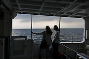 Iyo-Nagahama, Ehime prefecture, September 4 2015 - Yuri Kosaka and her friend on the boat for Aoshima. The boat travels to Aoshima only twice a day and the line is loss-making. Local goverment would like to close the line, although there are still 15 residents on the island.<br /> Aoshima (Ao island) is one of the several « cat islands » in Japan. Due to the decreasing of its poluation, the island now host about 6 times more cats than residents.