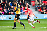 Cambridge United defender Elliott Ward in possession of the ball during the EFL Sky Bet League 2 match between Salford City and Cambridge United at Moor Lane, Salford, United Kingdom on 12 October 2019.