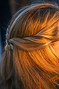 Braided blond hair on a young woman as seen from the back of her head close up