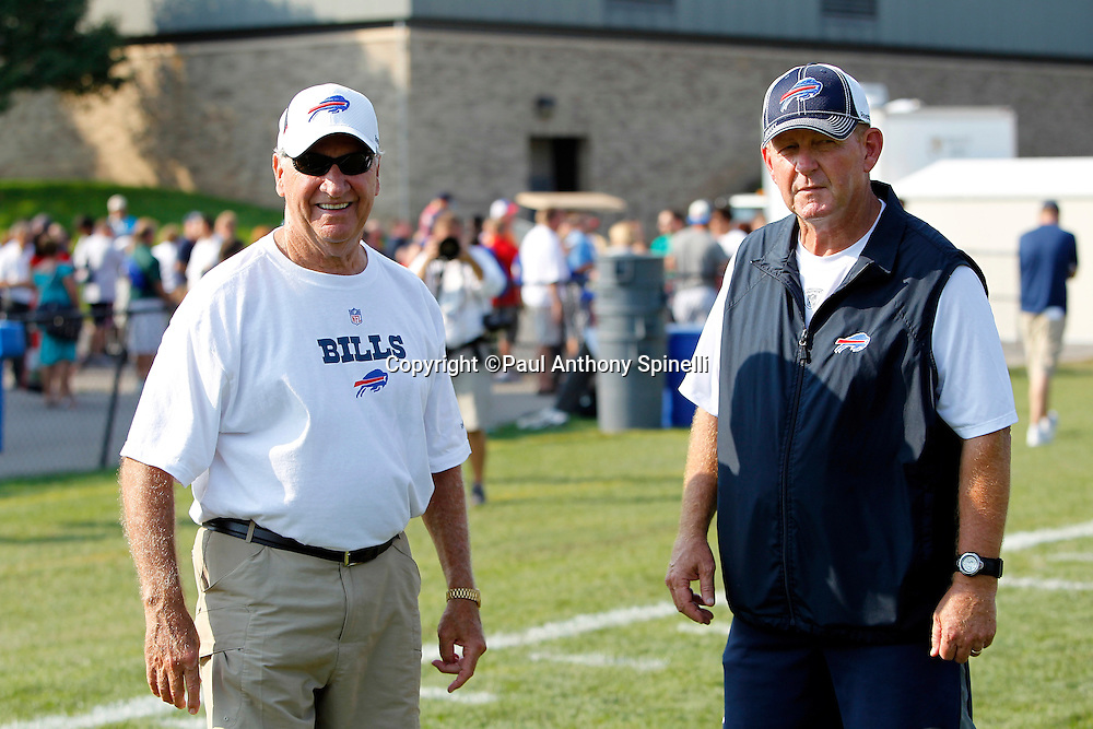 NFL Buffalo Bills General Manager Buddy Nix (left) and Head Coach Chan Gailey look on during training camp at St. John Fisher College on August 5, 2010 in Pittsford, New York. (©Paul Anthony Spinelli)