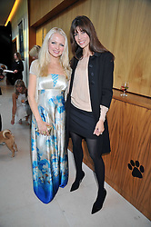 Left to right, HANNAH SANDLING and LISA BILTON at the annual Dog's Trust Honours Awards held at The Hurlingham Club, Fulham, London on 19th May 2009.