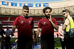 MADRID, SPAIN - Friday, May 31, 2019: Liverpool's Roberto Firmino and Mohamed Salah after a training session ahead of the UEFA Champions League Final match between Tottenham Hotspur FC and Liverpool FC at the Estadio Metropolitano. (Pic by Handout/UEFA)