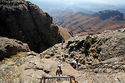 Walkers use the chain ladder to climb to the top of the Amphitheatre in the Drakensberg mountains. Royal Natal National Park. Kwa-Zulu Natal, South Africa..© Zute Lightfoot.Zute & Demelza Lightfoot.www.lightfootphoto.com