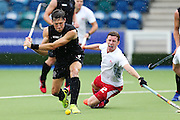 Simon Child of New Zealand takes a shot to score a goal during the bronze medal match between New Zealand and England. Glasgow 2014 Commonwealth Games. Hockey, Bronze Medal Match, Black Sticks Men v England, Glasgow Green Hockey Centre, Glasgow, Scotland. Sunday 3 August 2014. Photo: Anthony Au-Yeung / photosport.co.nz