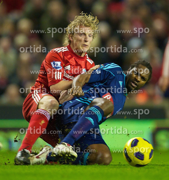 02.02.2011, Anfield Road, Liverpool, ENG, PL, Liverpool FC vs Stoke City, im Bild Liverpool's Dirk Kuyt and Stoke City's Salif Diao //  during the Premiership match against Liverpool at Anfield, EXPA Pictures © 2011, PhotoCredit: EXPA/ Propaganda/ D. Rawcliffe *** ATTENTION *** UK OUT!