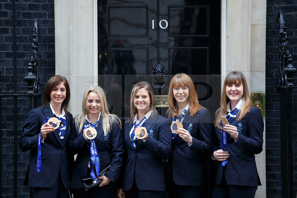 © licensed to London News Pictures. London, UK 25/02/2014. Women's Curling team posing with their medals as Winter Olympic medal winners of Team GB visiting Downing Street to meet Prime minister David Cameron on Tuesday, 25 February 2014 after their success in the Sochi 2014 Winter Olympics. Photo credit: Tolga Akmen/LNP