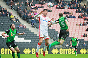 MK Dons Elliott Ward(15) wins this header during the EFL Sky Bet League 1 match between Milton Keynes Dons and Scunthorpe United at stadium:mk, Milton Keynes, England on 28 April 2018. Picture by Nigel Cole.