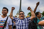 26 MAY 2014 - BANGKOK, THAILAND:  Men protest against the coup in Thailand at Victory Monument during a pro-democracy rally in Bangkok. About two thousand people protested against the coup in Bangkok. It was the third straight day of large pro-democracy rallies in the Thai capital as the army continued to tighten its grip on Thai life.  PHOTO BY JACK KURTZ
