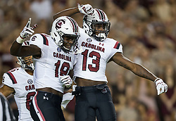 South Carolina wide receiver Shi Smith (13) and wide receiver OrTre Smith (18) react after a touchdown during the first quarter of an NCAA college football game against Texas A&M Saturday, Sept. 30, 2017, in College Station, Texas. (AP Photo/Sam Craft)
