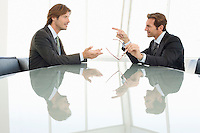 Business men talking at conference table