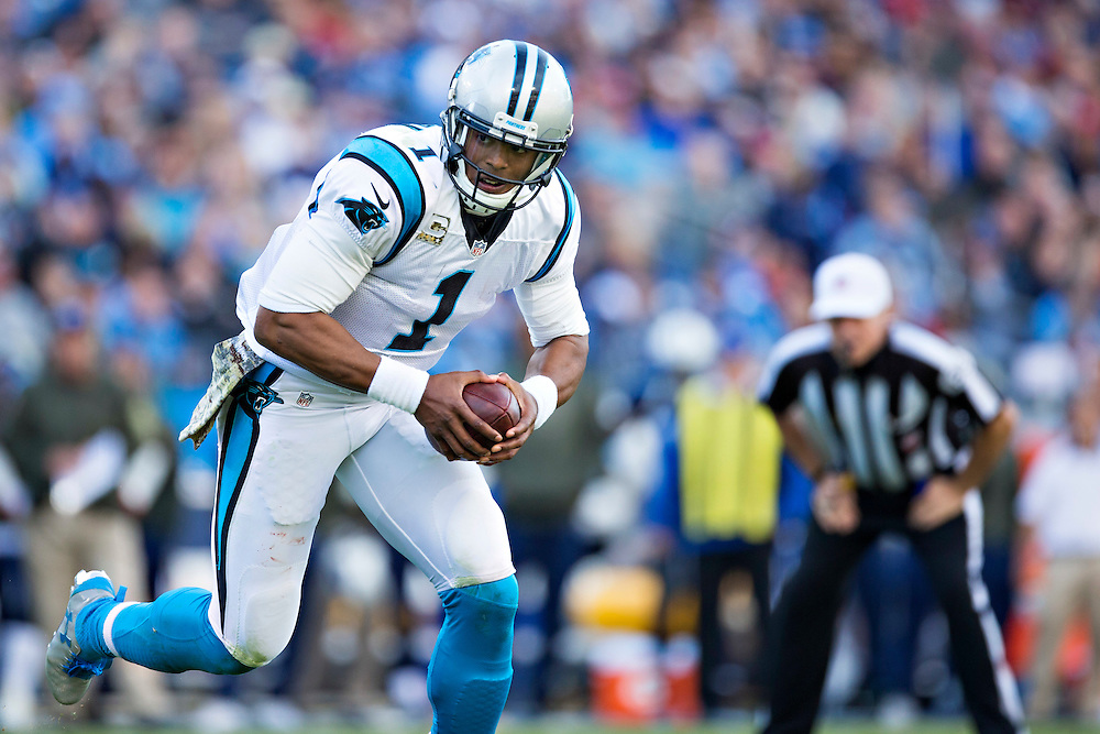NASHVILLE, TN - NOVEMBER 15:  Cam Newton #1 of the Carolina Panthers runs the ball during a game against the Tennessee Titans at Nissan Stadium on November 15, 2015 in Nashville, Tennessee.  (Photo by Wesley Hitt/Getty Images) *** Local Caption *** Cam Newton