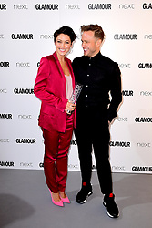 *EMBARGOED UNTIL 22:30 Tuesday 6th June 2017* Emma Willis (left) receives the TV Personality Award from Olly Murs in the press room at the Glamour Women of the Year Awards 2017, Berkeley Square Gardens, London.