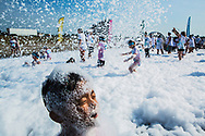"""May 12, 2018 - AJ Ongsingco, 6, of Memphis, emerges from a bed of suds during a bubble run at Memphis International Speedway in Millington on Saturday. Ongsingco's mother, Nicole, said it was their first time at the event. """"We didn't know it was going to be this fun,"""" Ongsingco said. (Yalonda M. James/The Commercial Appeal)"""