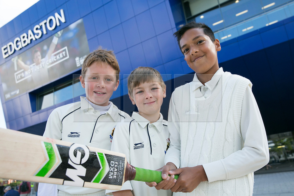 © Licensed to London News Pictures. 29_07_2015. Pictured, youngsters from local junior club, Kings Heath had come to watch in theur whites, GEORGE HANCOX, MASON BLAKE, WAQAR LATIF. Cricket fans arriving at Edgbaston cricket  ground for the start of the third test against Australia. Photo credit : Dave Warren/LNP