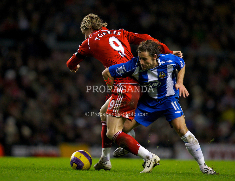 LIVERPOOL, ENGLAND - Wednesday, January 2, 2008: Liverpool's Fernando Torres and Wigan Athletic's Michael Brown during the Premiership match at Anfield. (Photo by David Rawcliffe/Propaganda)