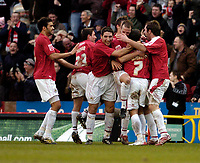 Photo: Leigh Quinnell.<br /> Bristol City v Middlesbrough. The FA Cup. 27/01/2007.<br /> Bristol City players celebrate with Scott Murray after his goal.