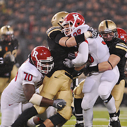 Oct 23, 2009; West Point, N.Y., USA; Rutgers running back Joe Martinek (38) is tackled by Army defenders during Rutgers' 27 - 10 victory over Army at Michie Stadium.