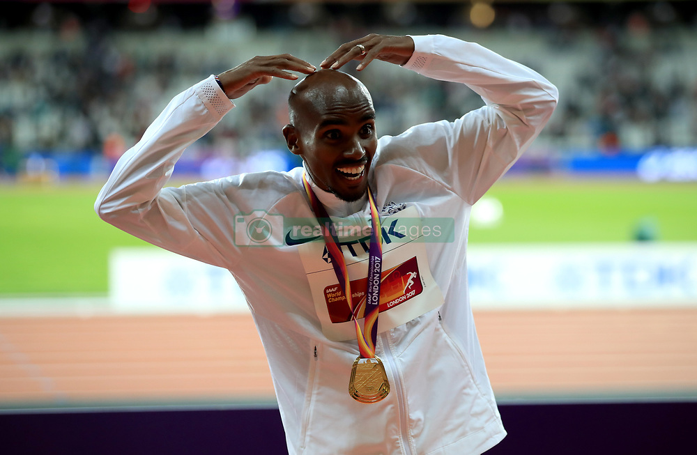 Great Britain's Mo Farah celebrates with his gold medal after winning the men's 10,000 metre final during day one of the 2017 IAAF World Championships at the London Stadium.