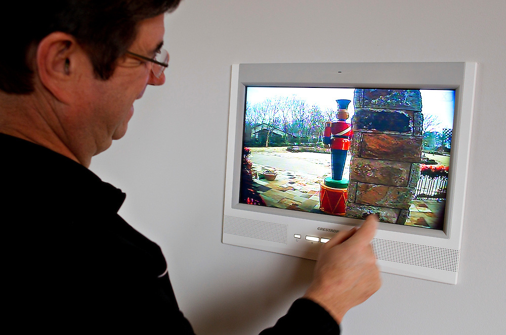 FORT SMITH, AR - JANUARY 7:  Sam Fiori looks at views of his home from outside cameras on a control panel in his home in Fort Smth, Arkansas that has been wired so that everything is controlled by a touchpad or a iPad.  .CREDIT:Wesley Hitt for The Wall Street Journal.TRAGICTECH