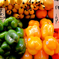 Green, Yellow, Orange Bell Peppers, Bananas at Public Market in Seattle, Washington