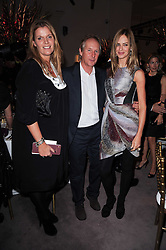 Left to right, JOHN & BELLE ROBINSON and TRINNY WOODALL at the Krug Mindshare auction held at Sotheby's, New Bond Street, London on 1st November 2010.