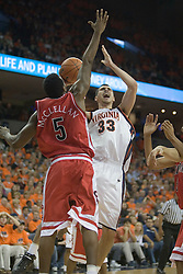 Virginia's Jason Cain (33) prepares a shot over Arizona's Jawann McClellan (5). UVA defeated the #10 ranked Wildcats 93-90 in the first game at the new John Paul Jones Arena, in Charlottesville, VA on November 12, 2006...