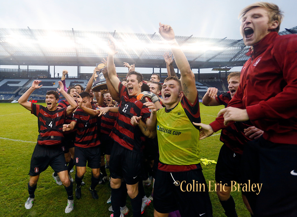 Experienced, Internationally Published College, Sports Photographer in Kansas City - Stanford University players celebrate winning the NCAA College Cup national championship soccer match against Clemson Saturday, Dec. 13, 2015, in Kansas City, Kan. Stanford beat Clemson 4-0. (AP Photo/Colin E. Braley)