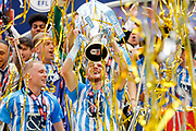 Coventry City defender Chris Stokes (3) lifts the trophy  during the EFL Sky Bet League 2 play-off final match between Coventry City and Exeter City at Wembley Stadium, London, England on 28 May 2018. Picture by Simon Davies.