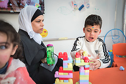 17 February 2020, Zarqa, Jordan: A boy plays while his mother waits for him to finish, in 'the nanny room' at the Lutheran World Federation community centre in Zarqa. Through a variety of activities, the Lutheran World Federation community centre in Zarqa serves to offer psychosocial support and strengthen social cohesion between Syrian, Iraqi and other refugees in Jordan and their host communities.
