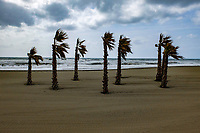 The sun doesn't always shine in Spain. - and the gentle cooling breeze is replaced by a chilly wind. The beach in question is at Estepona, Malaga Province. April 2017.  201704203427<br />
