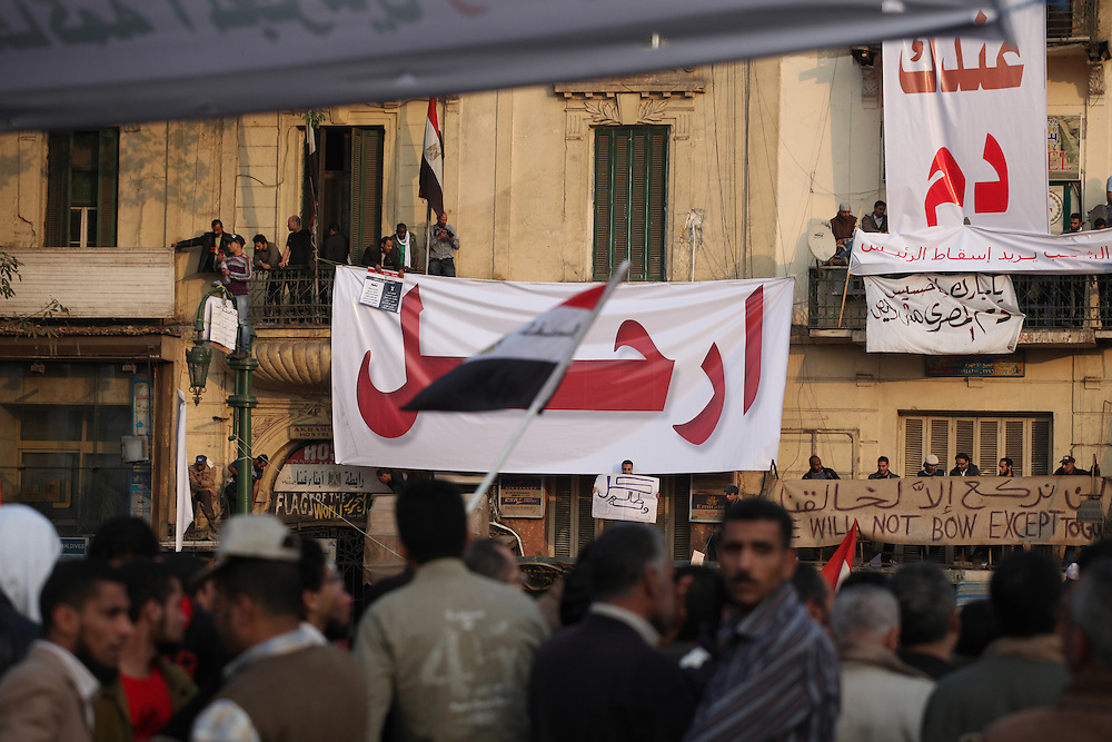 """A banner calls on Mubarak to """"irhal"""" (leave)."""