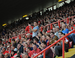 Bristol City fans take part in a  minutes applause on the 54th minute as a tribute to Mark Saunders who died today at the age of 54 after a battle with cancer.  - Photo mandatory by-line: Joe Meredith/JMP - Mobile: 07966 386802 - 27/09/2014 - SPORT - Football - Bristol - Ashton Gate - Bristol City v MK Dons - Sky Bet League One