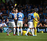 James Perch (QPR defender) getting the first yellow card of the match during the Sky Bet Championship match between Queens Park Rangers and Nottingham Forest at the Loftus Road Stadium, London, England on 12 September 2015. Photo by Matthew Redman.