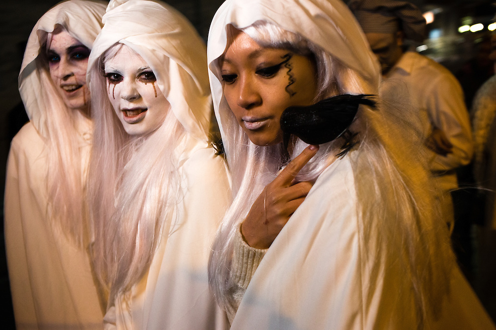 New York, NY - 31 October 2016. Three women with white hair wearing white outfits  in the Greenwich Village Halloween Parade.