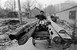 Timber from demolished houses being recycled in a hutong in Beijing
