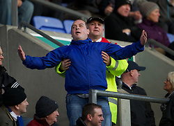 WIGAN, ENGLAND - Saturday, February 26, 2011: A rotund Wigan Athletic supporter taunts the Manchester United fans during the Premiership match at the DW Stadium. (Photo by David Rawcliffe/Propaganda)