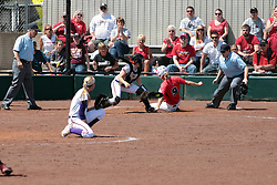 19 April 2014:  Sara Bradley slides in safely at home around the tag attempt by Kacey Rogers during an NCAA women's softball game between the Evansville Purple Aces and the Illinois State Redbirds on Marian Kneer Field in Normal IL