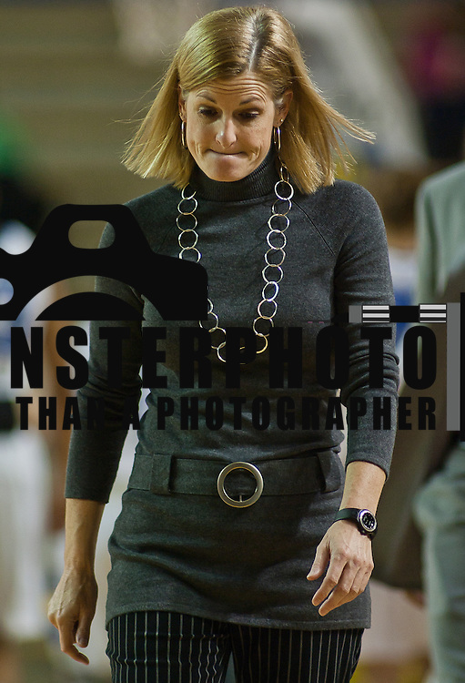 12/04/11 Newark DE: William & Mary Women's Head Coach Debbie Taylor walks off the floor after a Colonial Athletic Association lost to Delaware Sunday, Dec. 4, 2011 in front of before 3,061 fans at the Bob carpenter center in Newark Delaware...No. 24 Delaware (6-0) trounced William and Mary (4-3) 73-57 for best start in school history behind Elena Delle Donne 23 point scoring effort.