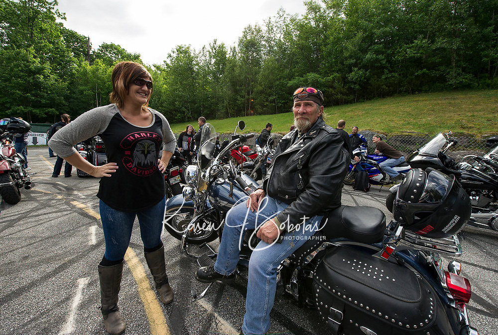 """Tracey Powell of Brookline, NH and Bruce Yowell of Gettysburg, PA line up with fellow riders for the """"Ride to the Sky"""" on Thursday morning at Laconia Harley in Meredith.  (Karen Bobotas/for the Laconia Daily Sun)"""