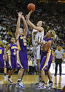December 22 2010: Iowa center Morgan Johnson (12) puts up a shot between Northern Iowa center Lizzie Boeck (20) and guard/forward Erin Brocka (44) during the second half of an NCAA college basketball game at Carver-Hawkeye Arena in Iowa City, Iowa on December 22, 2010. Iowa defeated Northern Iowa 75-64.
