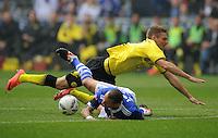 FUSSBALL   1. BUNDESLIGA   SAISON 2011/2012   31. SPIELTAG FC Schalke 04 - Borussia Dortmund                      14.04.2012 Lukasz Piszczek (hinten, Borussia Dortmund) gegen Jermaine Jones (am Boden, FC Schalke 04)